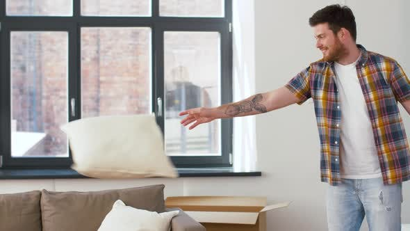Cover Image for Man Dropping Pillows and Jumping To Sofa at Home