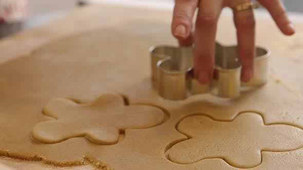 Thumbnail for Cutting out gingerbread men cookies