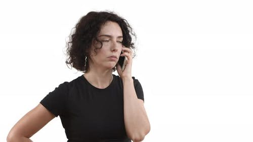 Closeup of Young Attractive Female Model with Curly Hair Wearing Black Tshirt Having Phone Call and