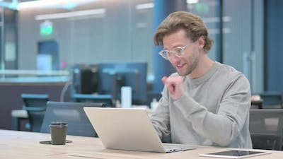 Young Businessman Talking on Video Call on Laptop