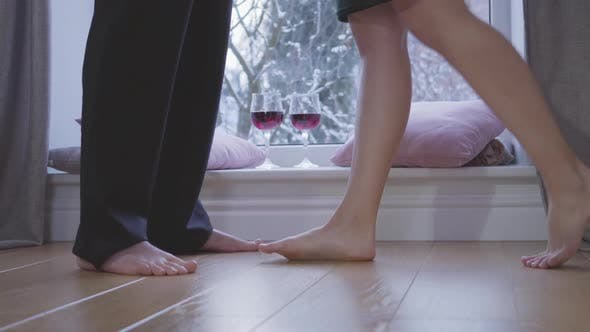 Thumbnail for Close-up Legs of Barefoot Caucasian Woman Coming To Unrecognizable Man. Seductive Girl Raising One
