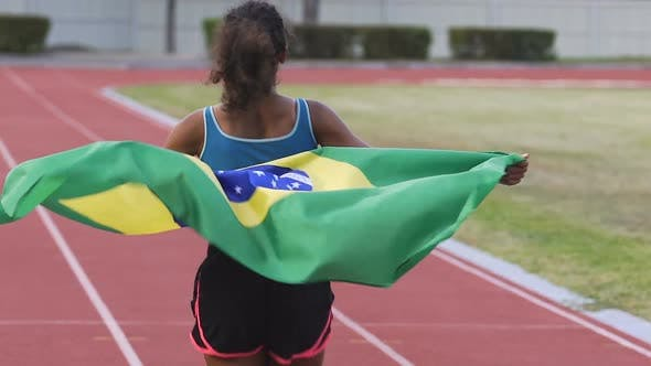Thumbnail for Young Biracial Winner of Sports Competition Running on Arena with Flag of Brazil