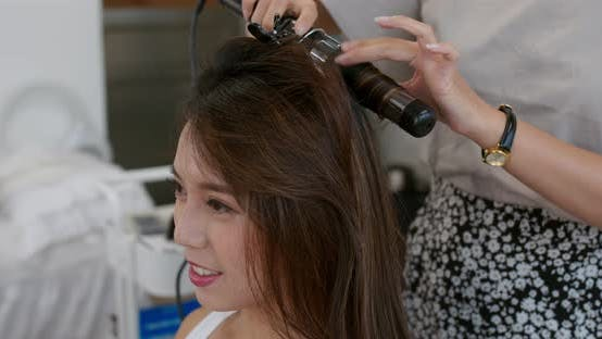Make up artist making a hairstyle for model