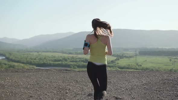 Thumbnail for Young Woman Fitness Runner on Top Happy and Celebrating Success