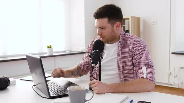 Thumbnail for Happy Young Man with Laptop and Microphone at Home 53