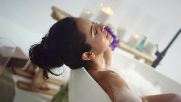 Thumbnail for Closeup Romantic Woman Taking Bath at Home. Sensual Girl Relaxing in Foam Bath.