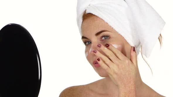 Thumbnail for Young Woman Applying Face Cream. Close Up, Bathroom