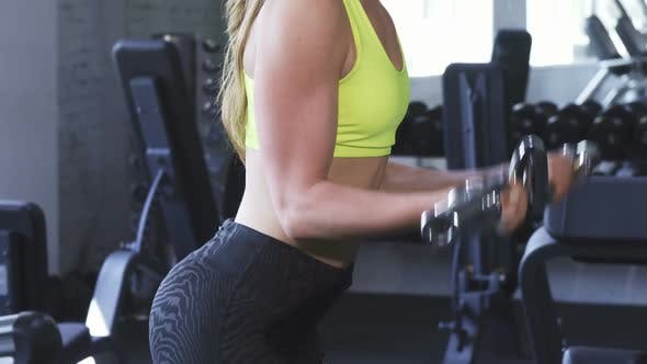 Thumbnail for Gorgeous Cheerful Sportswoman Doing Biceps Exercise at the Gym 1080p