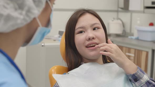 Thumbnail for Female Patient Telling Dentist about Her Teeth