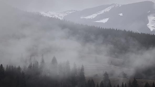 Thumbnail for Shreds of Fog over Wooded Mountains