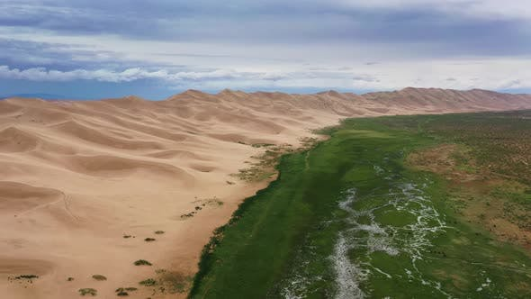 Thumbnail for Aerial View on Sand Dunes Under Cloudy Sky
