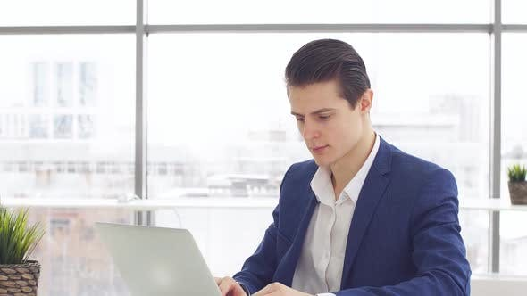 Thumbnail for Young Businessman Working Laptop in Office