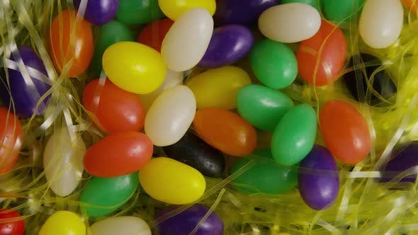 Thumbnail for Rotating shot of Easter decorations and candy in colorful Easter grass - EASTER 008