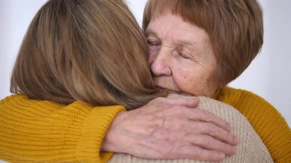 Thumbnail for Daughter And Senior Mother Hugging. Close-Up