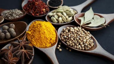 Various Indian Spices of Rotation Black Background.
