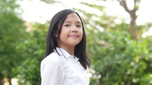 Slow Motion Of Happy Asian Girl In School Uniform