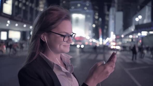 Thumbnail for Attractive Young Woman Walking in the City Streets Using Smart Phone