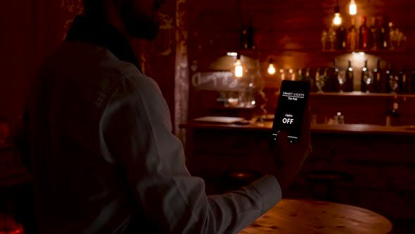 Thumbnail for Waiter Using His Voice To Activat the Lights in the Restaurant He Works