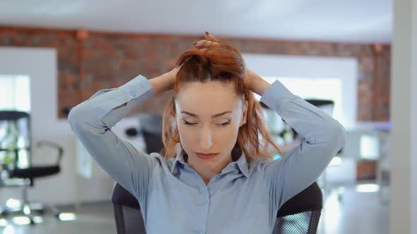 Thumbnail for Redhead Businesswoman Has a Migraine at Work
