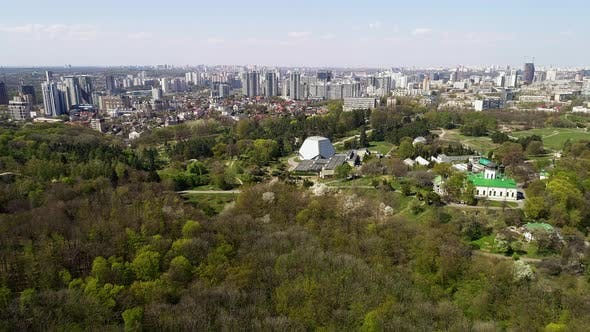 Botanical Garden on the Background of the Cityscape