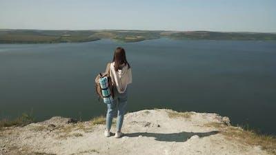 Female Traveller with Backpack Enjoying Bakota Area