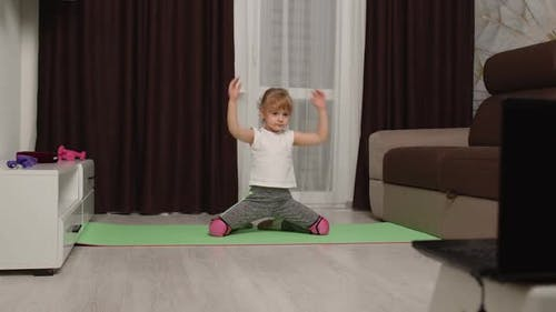 Child Kid Girl Doing Gymnastics Fitness Stretching Workout at Home Video Tutorial Distance Training