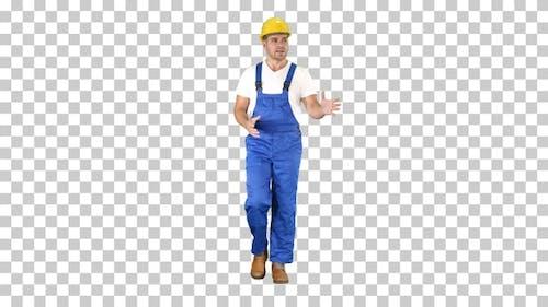 Foreman builder explaining something to camera and talking