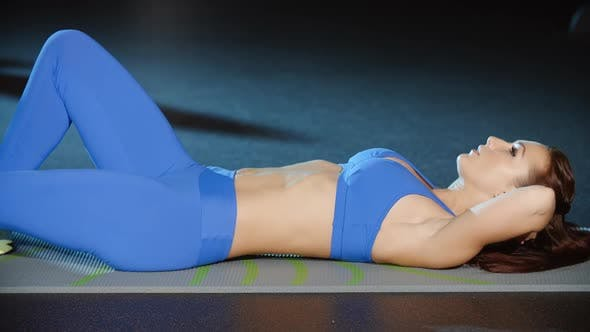 Thumbnail for Woman Athlete Doing Sit Ups Exercises Lifting Legs and Torso Cardio Fitness Routine