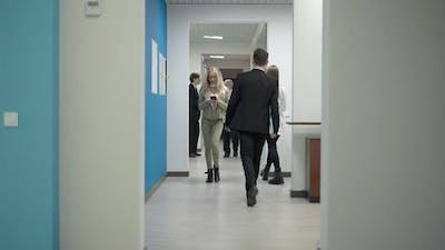 Busy Business People Walking in Office Corridor Indoors