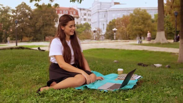 Thumbnail for Girl Skyping with Boyfriend in Park