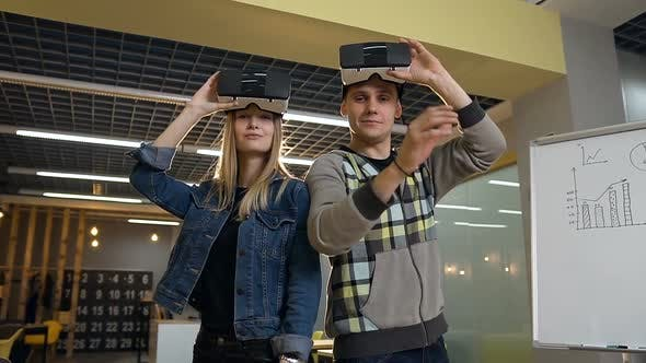 Thumbnail for Caucasian Business Man and Woman Removing Virtual Reality vr Glasses on the Office Background