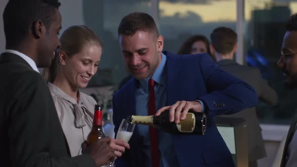 Cover Image for Joyous Business Team Having Fun and Drinking in Office