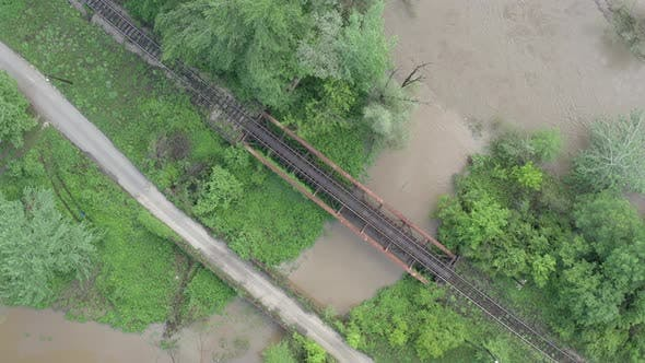 Thumbnail for Road and railway bridge above the river from drone perspective 4K drone video