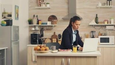 Business Woman Eating Breakfast