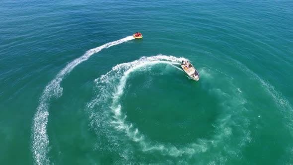 Thumbnail for Motor Boat Stretching from a Boat in Circles
