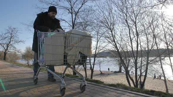 Cover Image for Front View of Homeless Mature Man Pushing Cart