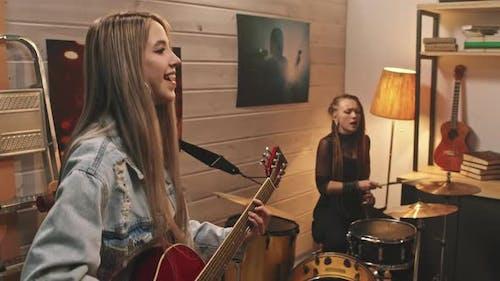 Young Women Playing Rock Music