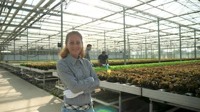 Female Agronomist Engineer Smiling in a Greenhouse