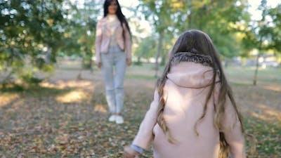 Little Girl Running to Hug Her Lovely Mom in the Park