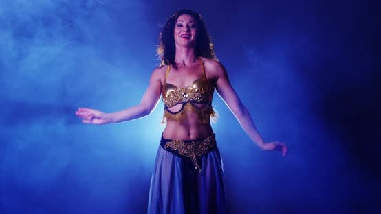 Thumbnail for Sexy woman belly dancing in studio