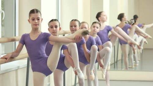 Little Ballerinas Doing Stretching Exercises at Barre