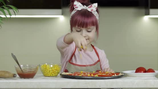 Thumbnail for Cooking Pizza. Little Child in Apron Adding Canned Corn To Dough in Kitchen