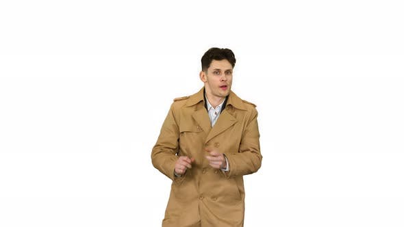 Thumbnail for Young Man Wearing Trench Coat Dancing and Having Fun on White Background.