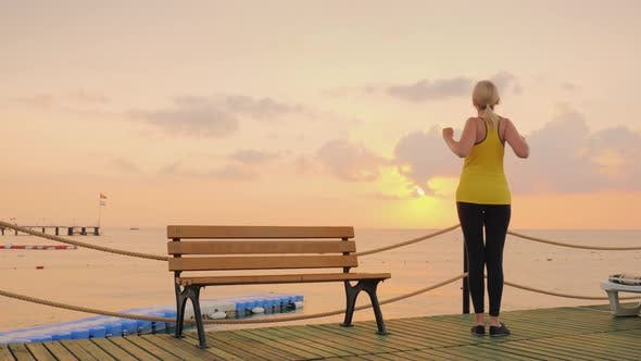 Thumbnail for Active Woman Doing Exercises on the Pier