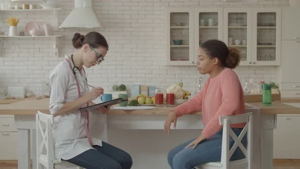 Thumbnail for Female Nutritionist Meeting Patient in the Kitchen