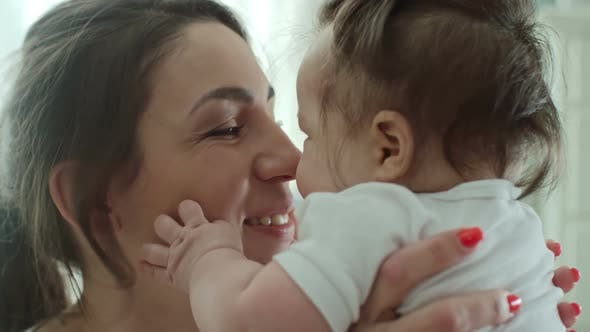 Thumbnail for Mother Giving Baby Eskimo Kiss