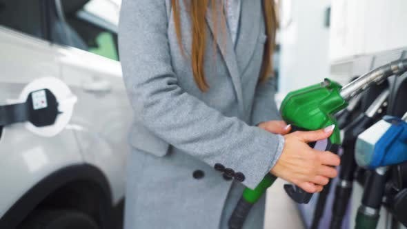 Thumbnail for Woman Fills Petrol Into Her Car at a Gas Station Close-up. Slow Motion