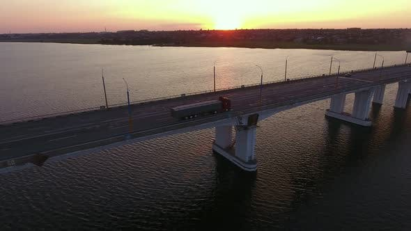 Thumbnail for Aerial Shot of a Stretched Bridge Over the Dnipro at Impressionist Sunset in Summer