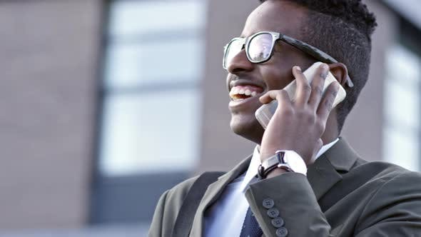 Cover Image for Black Businessman Talking on Phone and Smiling