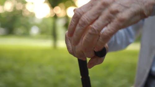Upset Stressed Retired Older Man Holding Hands on Cane